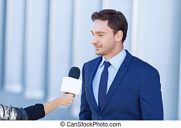 Young businessman is being interviewed. - Narrator time....
