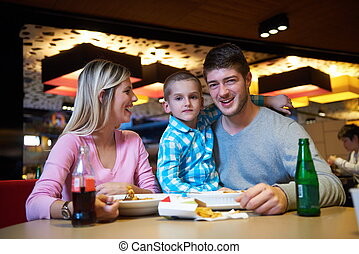 family having lunch in shopping mall