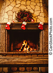 Warm cozy fireplace decorated for Christmas with real wood...