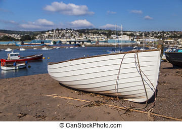 Dinghy - Boats shown along the Teignmouth estuary in Devon...