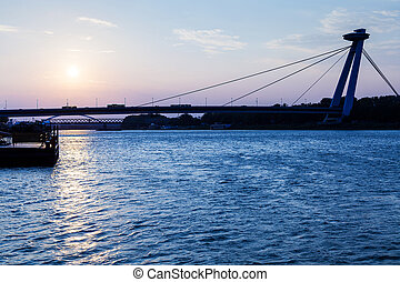 New bridge across Danube river at blue dawn - travel to...
