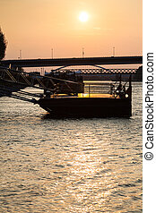 jetty on Danube river at yellow dawn - travel to Bratislava...