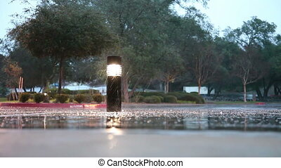Rain On Sidewalk With Pillar - Rain Falling By Lighted...