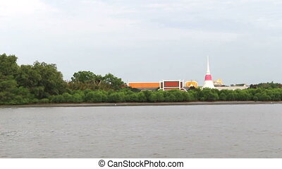 Riverside temple in Thailand - motion Riverside temple in...