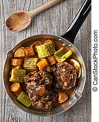rustic british oxtail stew - close up of rustic british...
