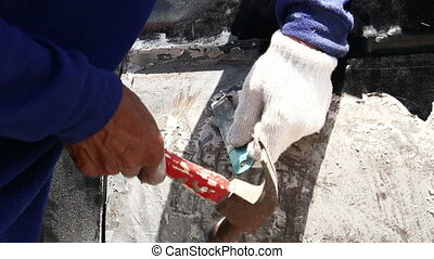 Man using a chisel wall color.