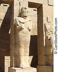 the Egyptian statue - Beaten out in stone walls the Egyptian...