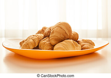Croissants in a white plate