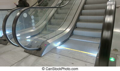 Train Station Escalators - Side view of escalator stairs...