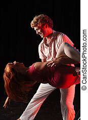 Dancers on stage - Caucasian male dancer lifting his female...