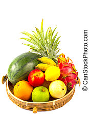 Composition with assorted fruits in wicker basket isolated on white