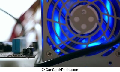 parts of the casing in neon light, selective focus on cooler...