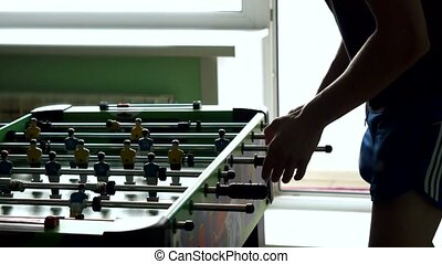 Young friends or students having fun together playing table...