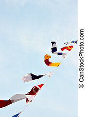 maritime flags against blue sky