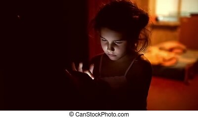 girl teen looking smartphone game on Internet in the...