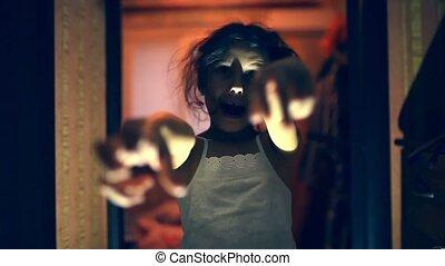 girl teen zombie is orange silhouette stretched indoor hands...