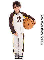 Adorable young kid in his sports dress with ball