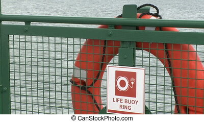 Life Buoy hangs on rail