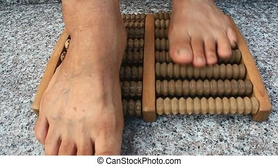foot massage with wooden tool