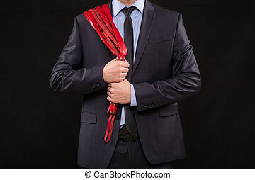 man in business suit with chained hands handcuffs for sex...