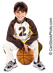 Kid stylishly sitting on the ball, isolated background
