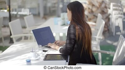 Businesswoman typing on her laptop computer