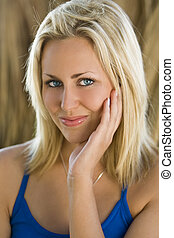 Smiling Beautiful Young Blond Woman With Blue Eyes