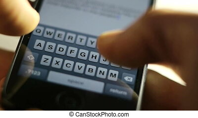 fingers typing a text message