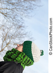young woman with a green wool cap and a scarf - attractive...