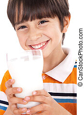 Happy kid drinking glass of milk on isoalted background