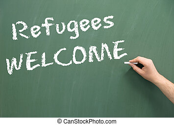 Refugees Welcome - Chalkboard with the words Refugees...