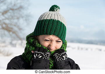 young woman is freezing on the walk - a young woman is...