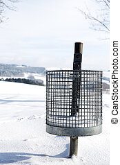 Trash can in the snow, concept winter tourism
