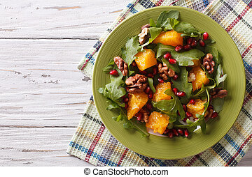 salad with pomegranate, oranges, arugula and nuts....