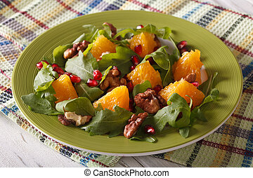Delicious salad with pomegranate, oranges, walnuts and...