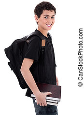 Side pose of handsome teenager boy student with books in...