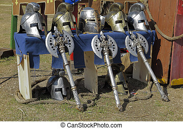 helmets and axes - medieval helmets and axes on a recreation...