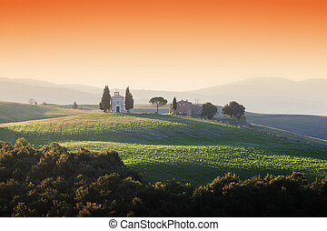 Tuscany landscape at sunrise with a little chapel of Madonna di Vitaleta, Italy.