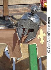 helmet - replica of an spartan helmet on a recreation of a...