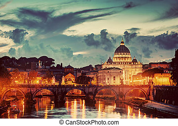 St. Peter Basilica, Vatican City.  Tiber river in Rome, Italy at late sunset, evening.