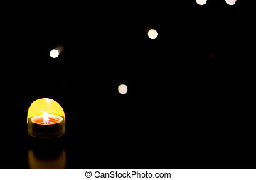 Light a candle in the dark with bokeh