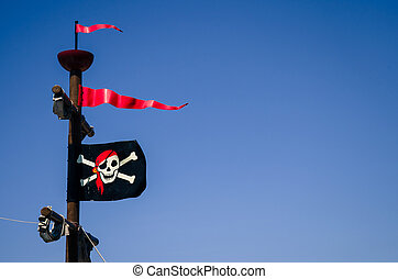pirate flag with skull and crossed bones and blue sky