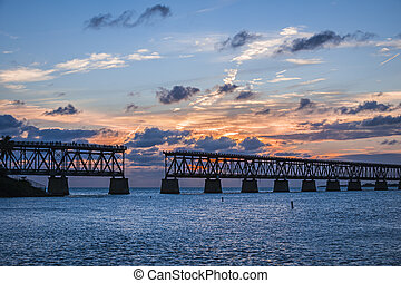 Old rail bridge at Florida Keys - Sunset view of historic...