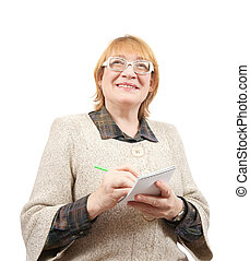 senior woman writing on a notebook