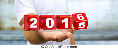 Man celebrating the new year 2016 - Man holding 2016 dices...