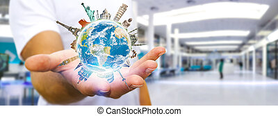Man travelling the world - Young man holding the planet...