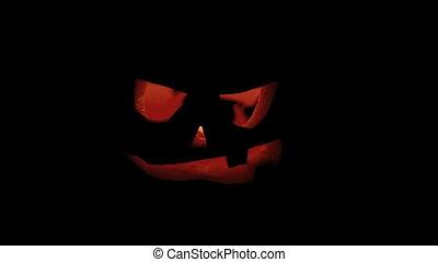 Flickering pumpkin for Halloween at night