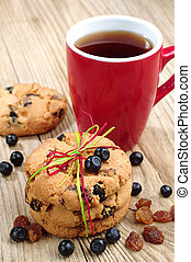 Cookies with raisins and blueberries and cup of tea