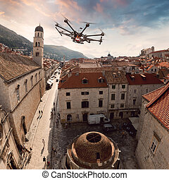 Octocopter, copter, drone - Copter flying above the old town...