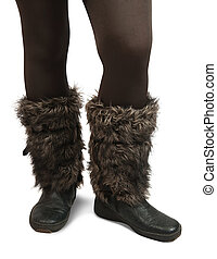 Woman feet in fur wintry  boots over white
